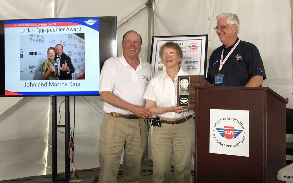 NAFI Chairman Bob Meder presented the Jack J. Eggspuehler Service Award to John and Martha at the annual NAFI Member Breakfast at EAA AirVenture in Oshkosh, Wisconsin.